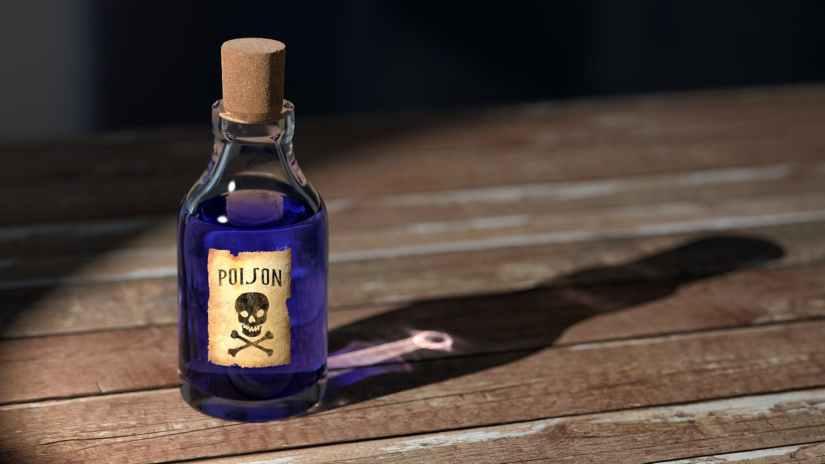purple liquid poison on brown wooden surface